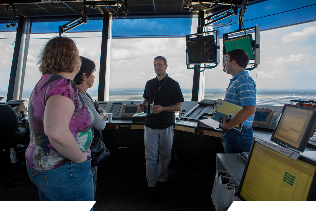 students in a flight control tower at an airport