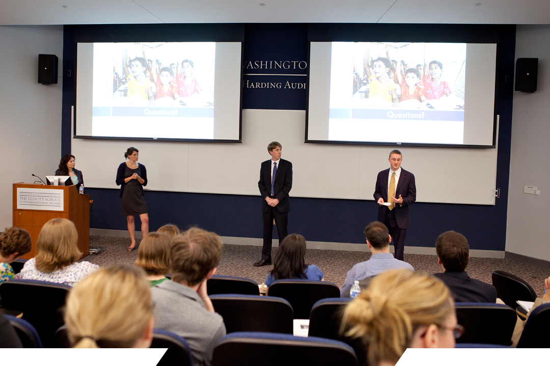 students presenting a topic in front of an audience