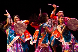 Raas Chaos dancers in colorful garb