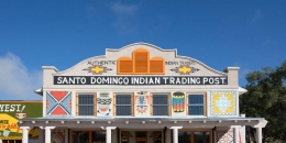 "19th-century building with a sign that says ""Santo Domingo Indian Trading Post"""