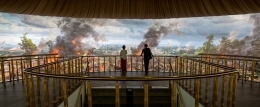 Photo of people standing on a balcony at the Angkor Panorama Museum