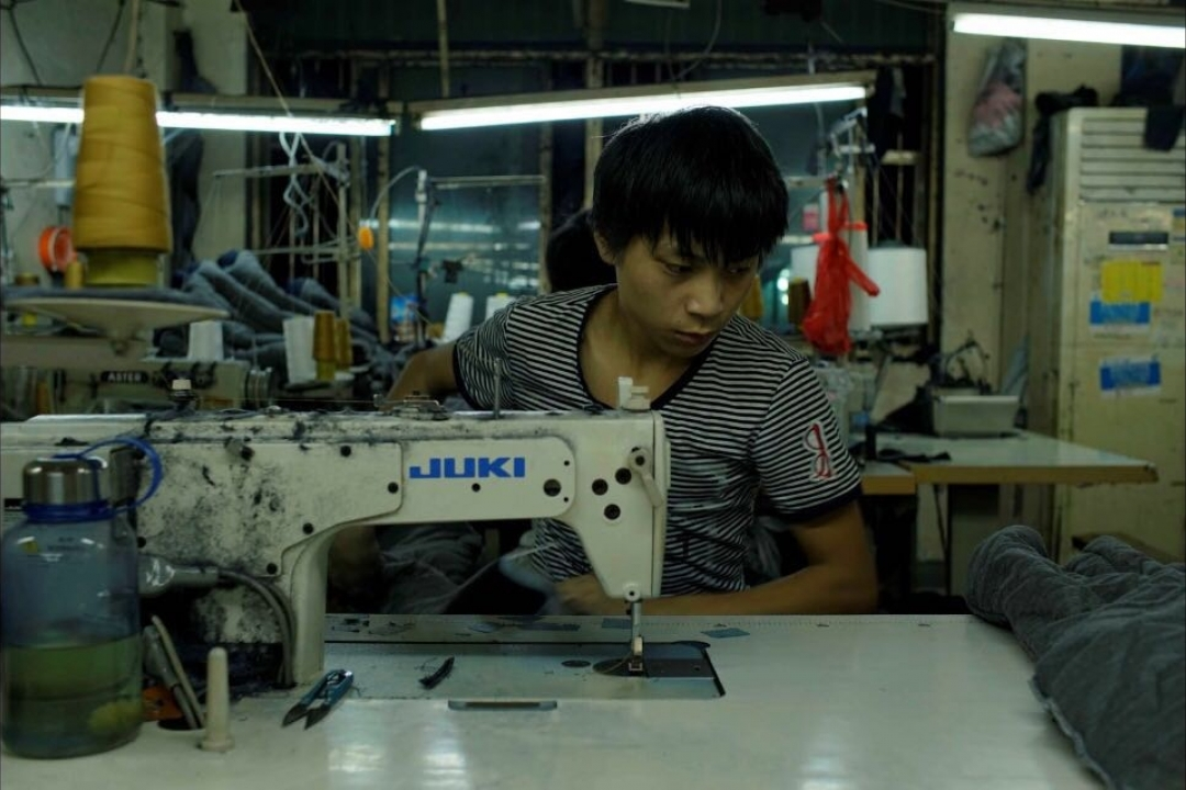 Worker at sewing machine