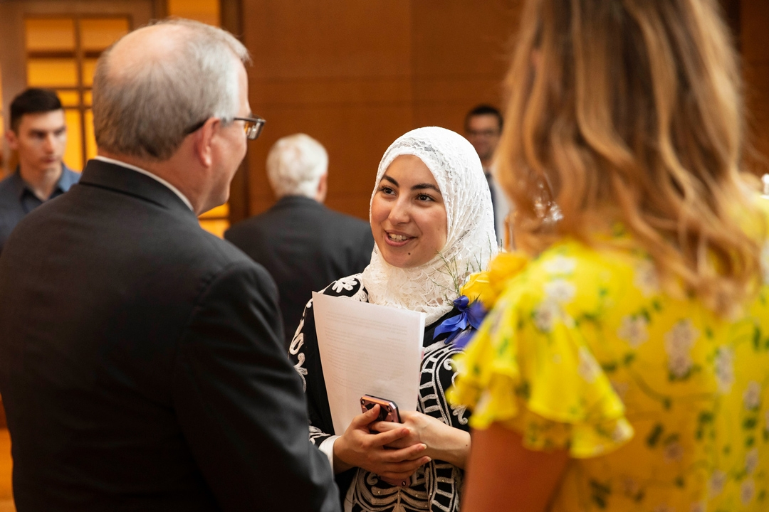 Students speaking with President LeBlanc during the 2018 Interfaith Baccalaureate