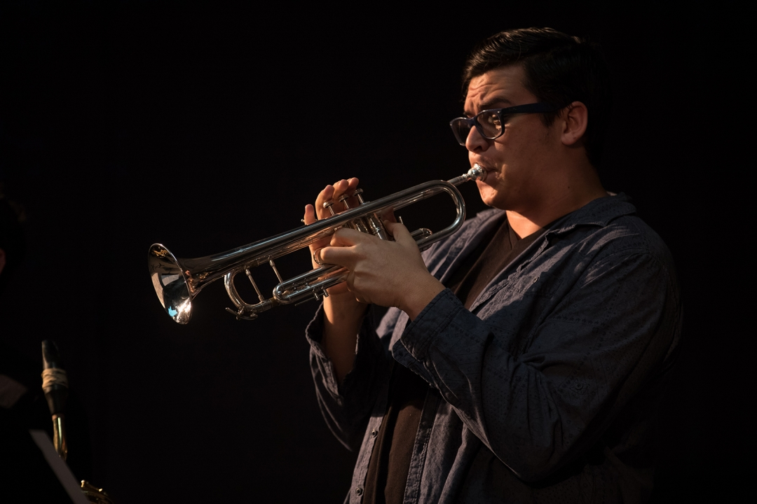 Student blowing a trumpet