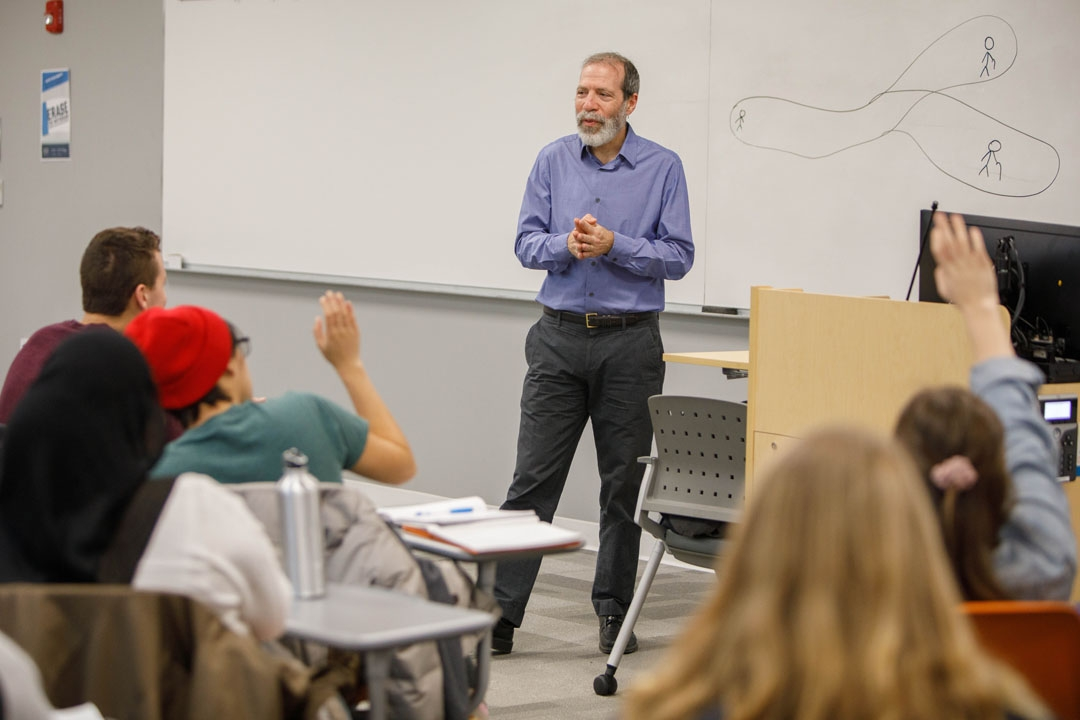 Assistant Professor of Philosophy of Eric Saidel leads a class