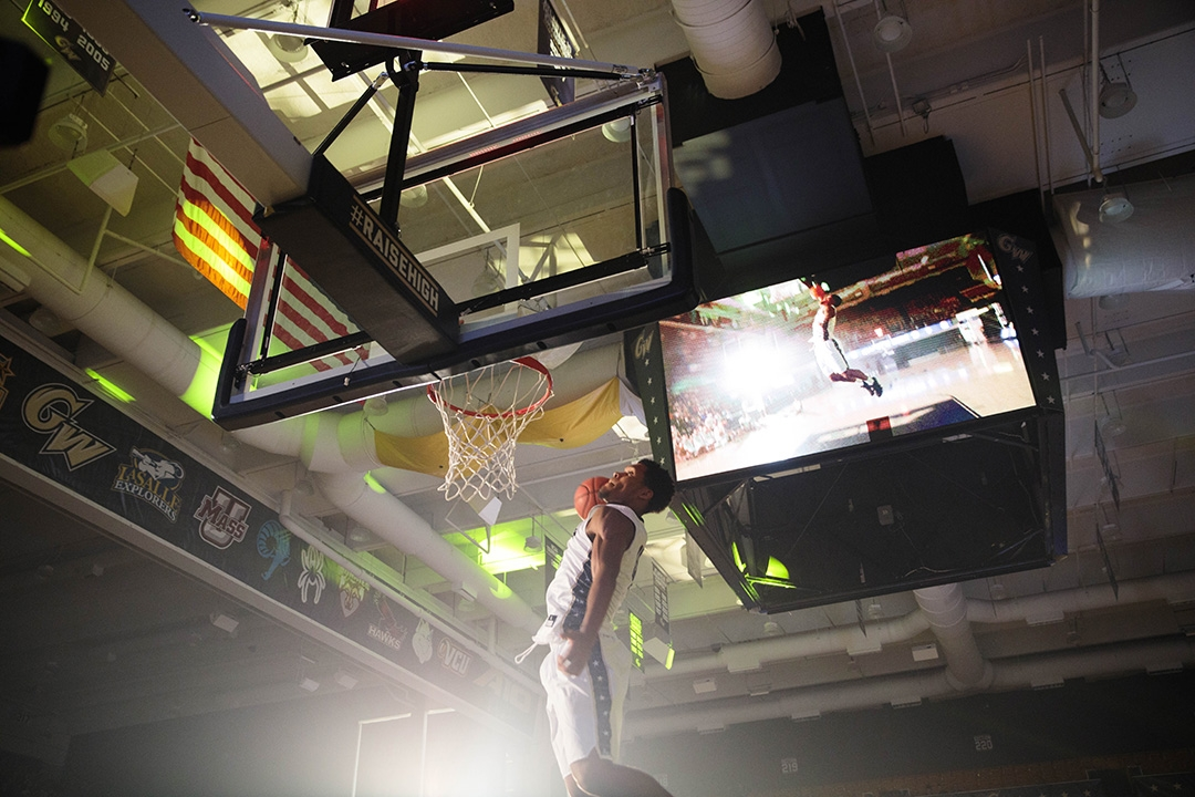 GW men's basketball player dunking the ball during G Dub Madness