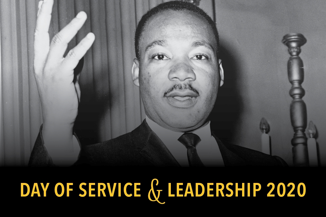 """Image of Dr. Martin Luther King Jr. standing and gesturing. Imposed over the image are the words """"Day of Service & Leadership"""""""